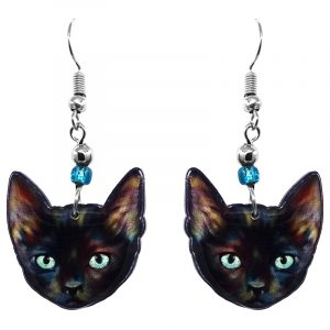 Tortoiseshell cat face acrylic dangle earrings with beaded metal hooks in black, light blue, and multicolored color combination.