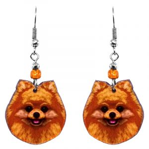 Mia Jewel Shop: Pomeranian dog face acrylic dangle earrings with beaded metal hooks in orange, tan, and black color combination.