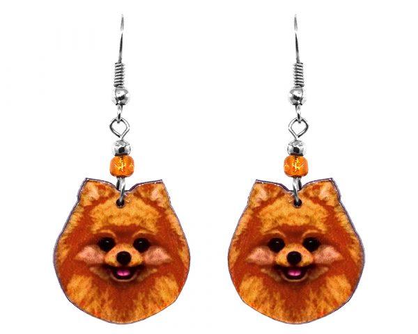 Mia Jewel Shop: Pomeranian dog face acrylic dangle earrings with beaded metal hooks in orange, tan, and black color combination.