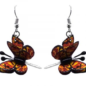 Three-dimensional butterfly durable plastic dangle earrings in gold yellow, dark orange, and black color combination.