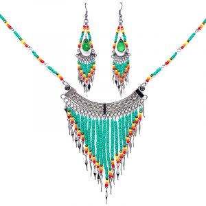 Native American inspired beaded chain necklace with long seed bead and alpaca silver metal fringe dangles and matching teardrop-shaped glass bead chandelier earrings in mint, gold, yellow, orange, and red color combination.