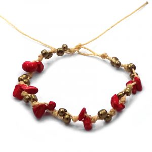 Macrame string bracelet with red jasper chip stones and seed beads in red, gold, and beige color combination.