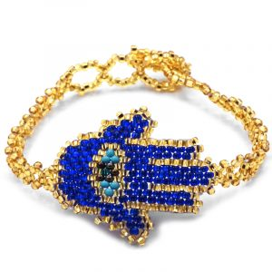 Czech glass seed bead bracelet with hamsa hand centerpiece in royal blue, gold, and turquoise color combination.