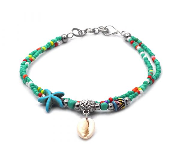 Seed bead multi strand bracelet with natural seashell dangle, starfish bead, and tribal bead centerpiece in mint green, turquoise, multicolored, and white color combination.