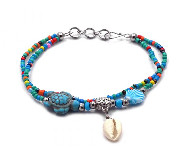 Seed bead multi strand bracelet with natural seashell dangle, sea turtle bead, and clam shell bead centerpiece in turquoise blue, multicolored, and white color combination.