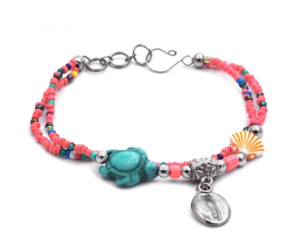 Seed bead multi strand bracelet with silver metal seashell charm dangle, sea turtle bead, and clam shell bead centerpiece in salmon pink, turquoise, orange, white, and multicolored color combination.