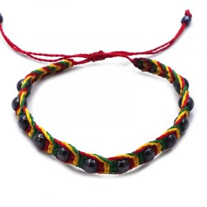 Striped macramé pull tie bracelet with hematite beads in Rasta colors.