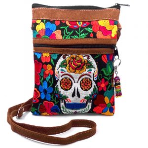 Medium-sized slim rectangular brown vegan leather purse bag with cotton embroidered Day of the Dead sugar skull and floral designs in black and multicolored color combination.