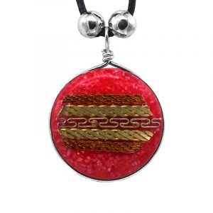 Round-shaped acrylic resin and crushed chip stone inlay pendant with multicolored metal tribal pattern design on adjustable necklace in red color.