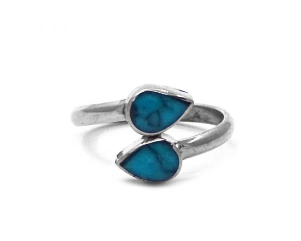 Double mini teardrop-shaped gemstone cabochons on alpaca silver metal ring in turquoise blue howlite.