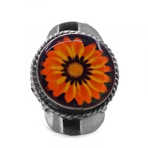 Round-shaped acrylic flower graphic design on alpaca silver metal ring with rope edge border in orange, golden yellow, and black color combination.