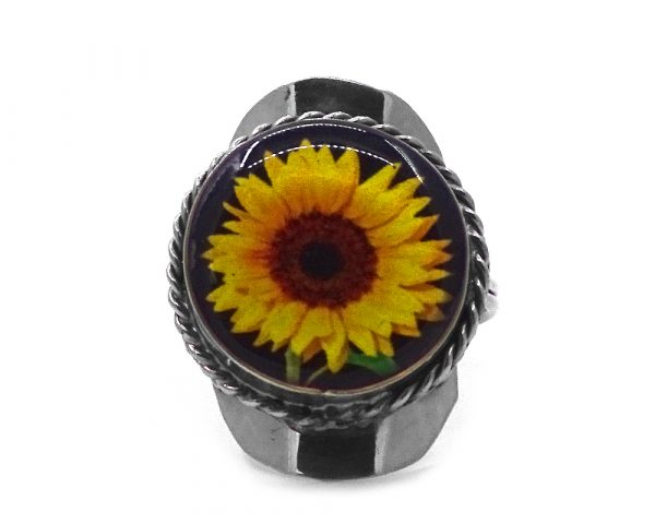 Round-shaped acrylic flower graphic design on alpaca silver metal ring with rope edge border in yellow, golden yellow, brown, lime green and black color combination.