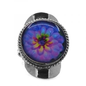 Round-shaped acrylic flower graphic design on alpaca silver metal ring with rope edge border in lavender, purple, magenta, blue, turquoise, yellow, and lime green color combination.