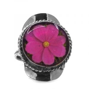 Round-shaped acrylic flower graphic design on alpaca silver metal ring with rope edge border in hot pink, yellow, and lime green color combination.