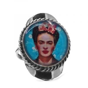 Round-shaped acrylic Frida Kahlo face graphic design on alpaca silver metal ring with rope edge border in turquoise blue, white, peach, pink, red, and black color combination.