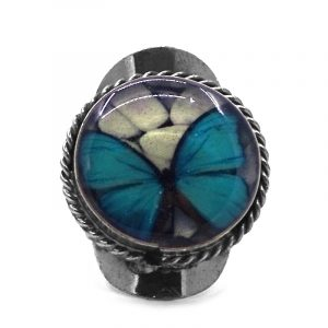Round-shaped acrylic butterfly graphic design on alpaca silver metal ring with rope edge border in turquoise blue, white, and black color combination.