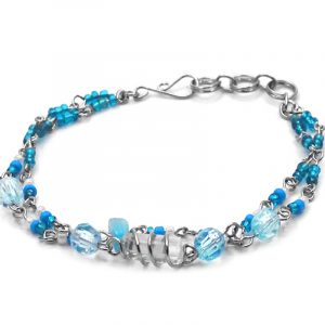 Seed bead and crystal bead double strand silver metal chain bracelet with wire wrapped natural clear quartz crystal centerpiece in light blue, turquoise, and white color combination.