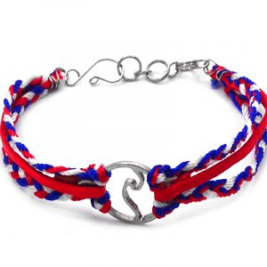 Suede vegan leather and braided macramé thread multi strand bracelet with silver metal round wave charm centerpiece in American flag USA colors.