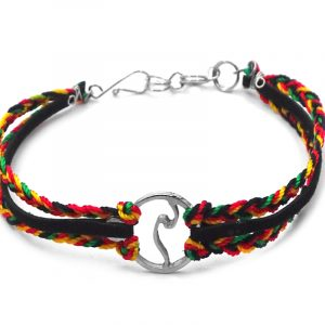 Suede vegan leather and braided macramé thread multi strand bracelet with silver metal round wave charm centerpiece in Rasta colors.