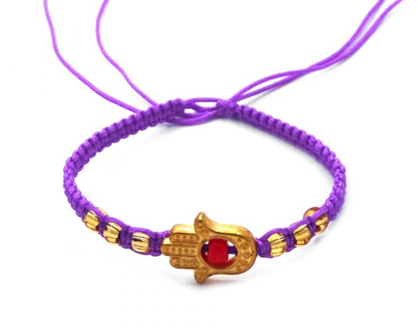 Macramé bracelet with gold-colored metal hamsa hand charm and seed bead centerpiece in purple and red color combination.