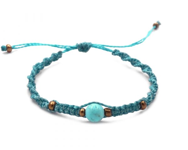 Macramé pull tie bracelet with turquoise howlite gemstone ball bead and seed bead centerpiece in turquoise blue color.