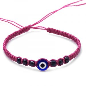 Macramé bracelet with evil eye bead and seed bead centerpiece in blue, pink, white, and black color combination.