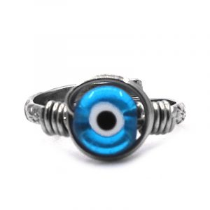 Handmade mini round-shaped wire wrapped evil eye bead on adjustable alpaca silver metal ring in turquoise blue, black, and white color combination.