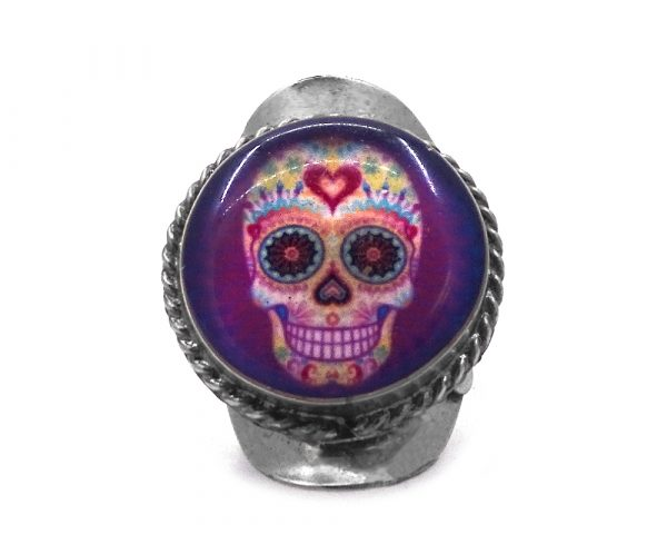 Round-shaped acrylic Day of the Dead sugar skull graphic design on alpaca silver metal ring with rope edge border.