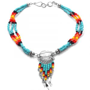 Handmade Native American inspired seed bead multi strand anklet with silver metal wire wrapped natural clear quartz crystal and beaded dangles in light turquoise blue, black, red, orange, and yellow color combination.