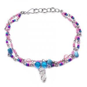 Handmade seed bead, crystal bead, and chip stone multi strand silver metal chain anklet with wire wrapped natural clear quartz crystal dangle in light pink, purple, and turquoise blue color combination.