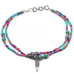 Handmade seed bead and crystal bead multi strand anklet with wire wrapped natural clear quartz crystal dangle in mint green, pink, hot pink, orange, and lavender purple color combination.