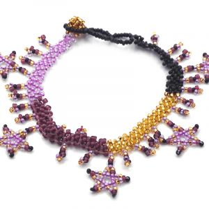 Handmade Czech glass seed bead anklet with beaded stars and fringe dangles in purple, lavender, gold, and black color combination.