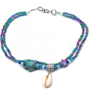 Handmade seed bead multi strand anklet with natural seashell, sea turtle stone bead, and tribal pattern bead centerpiece in turquoise blue, purple, and green color combination.