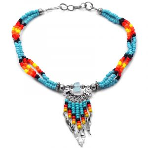 Handmade Native American inspired seed bead multi strand anklet with chip stone and beaded dangles in turquoise blue, black, red, orange, and yellow color combination.