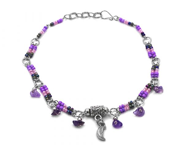 Handmade seed bead silver metal chain anklet with metal crescent half moon charm and chip stone dangles in purple, light pink, and iridescent color combination.