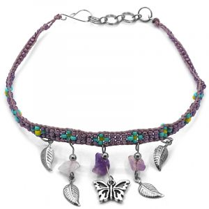 Handmade floral seed bead strap anklet with chip stones, silver metal butterfly charm, and leaf charm dangles in purple, lavender, turquoise, and yellow color combination.