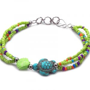 Handmade seed bead multi strand bracelet with sea turtle shaped tumbled magnesite gemstone centerpiece in lime green, turquoise, and multicolored color combination.