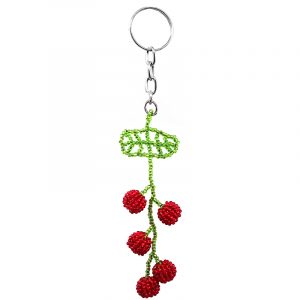 Handmade Czech glass seed bead figurine keychain of cherries on a leaf in red and lime green color combination.