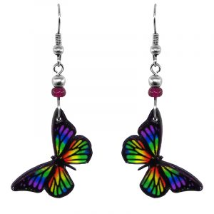 Handmade monarch butterfly earrings with acrylic, seed beads, and metal hooks in black and rainbow color combination.